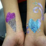 Temp tattoos, airbrush, UV glow paint, and other art based teen event services by www.magikidz.com